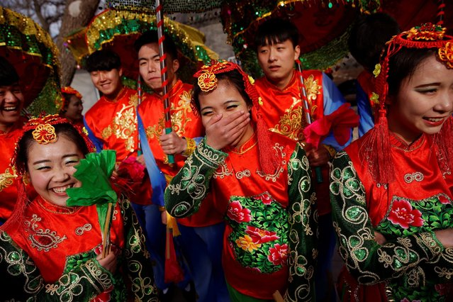Performers share a light moment before going onto stage at the Longtan park as the Chinese Lunar New Year, which welcomes the Year of the Rooster, is celebrated in Beijing, China January 29, 2017. (Photo by Damir Sagolj/Reuters)