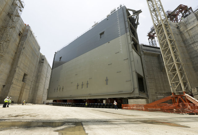 The last steel rolling gate stands ready to be installed at the Panama Canal in Cocoli near Panama City, Tuesday, April 28, 2015. The Panama Canal Authority supervised the installation of the last of 16 giant lock gates that are a key part of the waterway's multibillion-dollar expansion. The construction of the third set of locks will allow the passage of Post-Panamax vessels or container ships much too big to fit through the Panama Canal's old locks. (Photo by Arnulfo Franco/AP Photo)