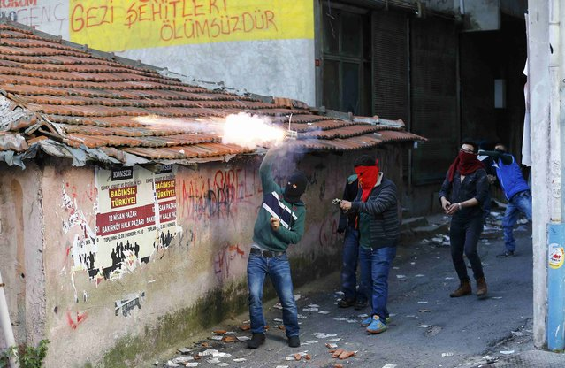 Protesters fire firecrackers as they clash with police in Okmeydani neighbourhood of Istanbul, Turkey, May 1, 2015. (Photo by Umit Bektas/Reuters)