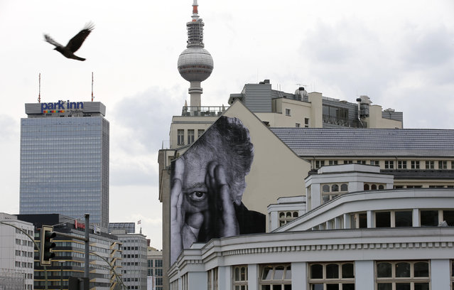 "A bird flies beside a creation, part of the ""Wrinkles Of The City"" project, near the television tower in Berlin, Germany April 19, 2013. (Photo by Fabrizio Bensch/Reuters)"