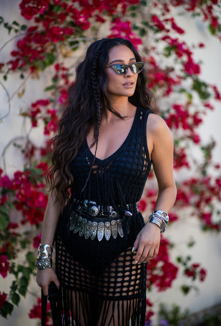 Shay Mitchell wearing black sheer dress with fringes is seen at Revolve Festival during Coachella Festival on April 13, 2019 in La Quinta, California. (Photo by Christian Vierig/Getty Images)