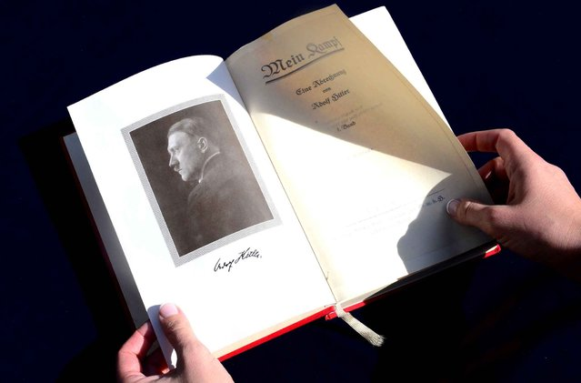 """One of two rare copies of """"Mein Kampf"""" signed by the young Nazi leader Adolf Hitler and due for auction, photographed in Los Angeles, California on February 25, 2014. The two-volume set – a first edition and a second edition – of the future German Fuehrer's political manifesto will be sold online to the highest bidder Thursday February 26 according to Nate D. Sanders Auctions. (Photo by Frederic J. Brown/AFP Photo)"""