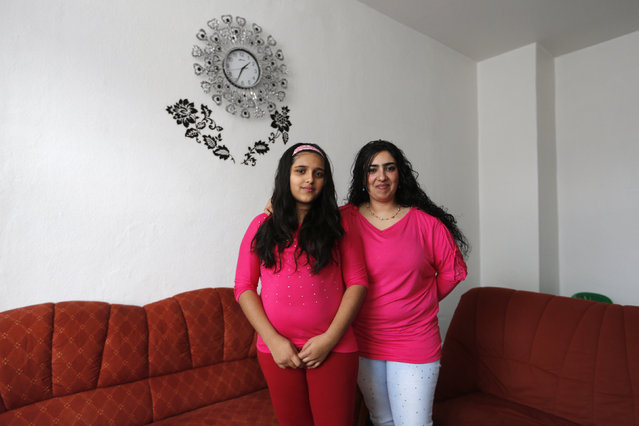 Bulgarian migrant Ayshe Kakarmustafa, 33, and her daughter Neriman, 11, pose for a photograph at their home in Dortmund, Germany February 22, 2014. Ayshe finished school at 14 and used to work in a shoe factory in Bulgaria. When she was a girl, she wanted to become a hairdresser. Ayshe hopes that her daughter Neriman will do whatever she wants when she grows up. Neriman would like to become a doctor. (Photo by Ina Fassbender/Reuters)