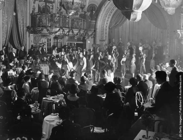 The audience watches the grand finale of the first ever afternoon cabaret performance in Britain, which took place in Princes Restaurant