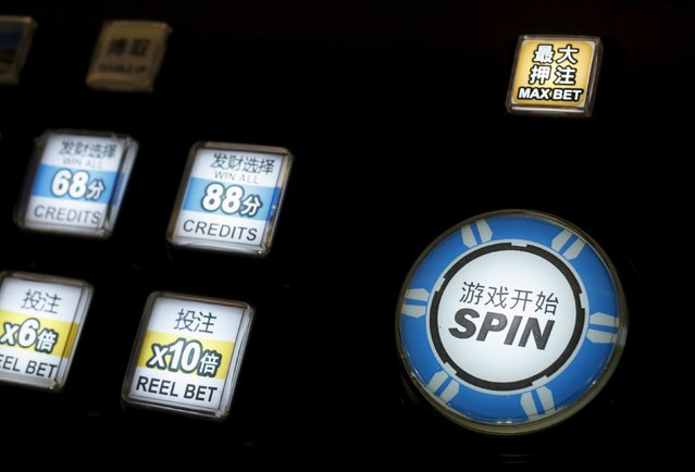 Buttons of a slot machine are lit at the Global Gaming Expo (G2E) Asia in Macau, China May 19, 2015. (Photo by Bobby Yip/Reuters)