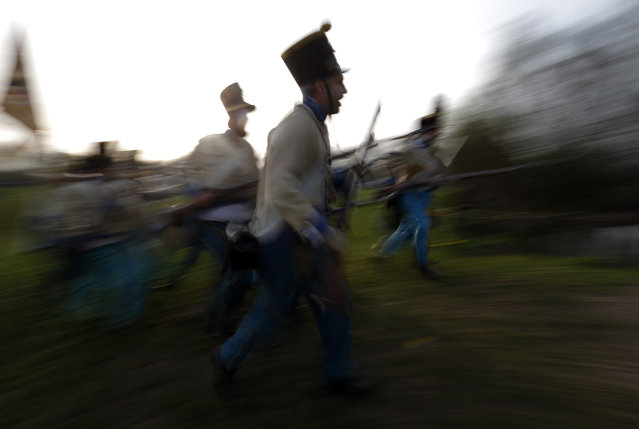 People dressed as Austrian soldiers of the Habsburg dynasty take part in the re-enactment of the battle against Hungary in Tapiobicske, Hungary April 4, 2016. (Photo by Laszlo Balogh/Reuters)
