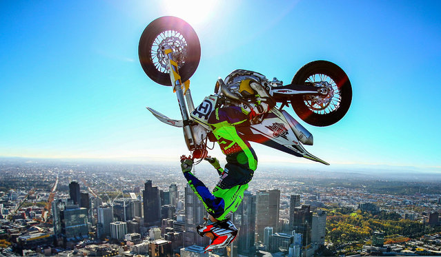 World Champion Trials bike rider Jack Field of Australia poses after performing the highest backflip on a motorcycle ever recorded as he flips his motorbike upside down on the roof of Melbourne's Eureka Tower (297.3 metres) during a AUS-X Open media opportunity at Eureka Tower on May 22, 2019 in Melbourne, Australia. The largest international Supercross and action sports event in the world outside of the USA, the AUS-X Open will be held at Melbourne's Marvel Stadium on November 30 2019. (Photo by Scott Barbour/Getty Images)