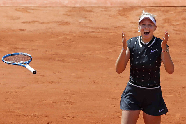 Amanda Anisimova of the U.S. celebrates winning her quarterfinal match of the French Open tennis tournament against Romania's Simona Halep in two sets, 6-2, 6-4, at the Roland Garros stadium in Paris, Thursday, June 6, 2019. (Photo by Christophe Ena/AP Photo)