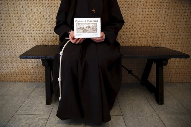 "Sister Isabel, 39, a cloistered St. Clare nun, poses with a box of sweets ""Caprichos de Dulcinea"" (Dulcinea cravings) made at her convent in the hometown of Don Quixote's ladyship Dulcinea, in El Toboso, Spain, April 6, 2016. (Photo by Susana Vera/Reuters)"