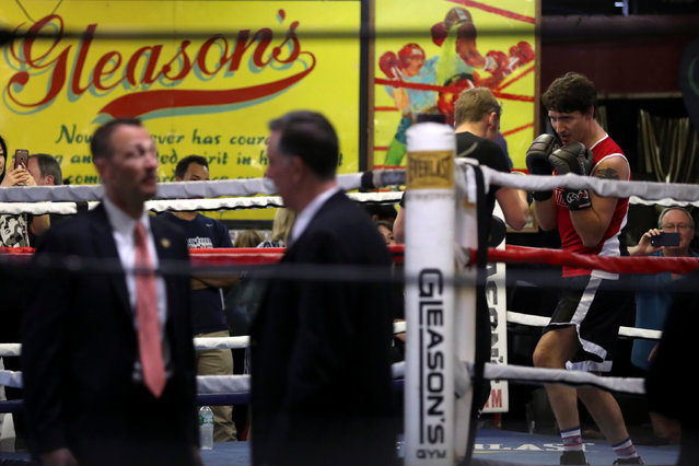 Secret service agents talk in the foreground as Canadian Prime Minister Justin Trudeau spars in the ring at Gleason's Boxing Gym in the Brooklyn borough of New York, U.S., April 21, 2016. (Photo by Carlo Allegri/Reuters)