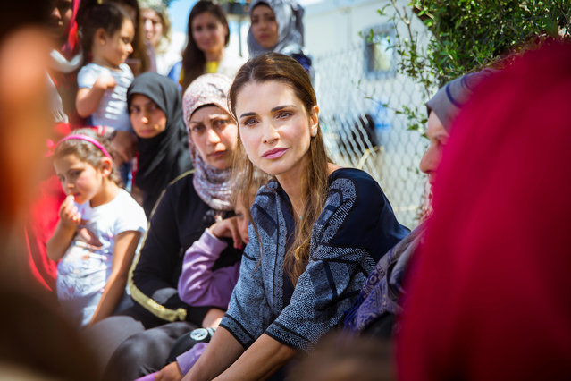 In this picture provided by the Office of Her Majesty Press Department, Queen Rania of Jordan, center, meets with refugees and migrants during her visit to Kara Tepe municipality camp in the Greek island of Lesbos, Monday, April 25, 2016. (Photo by Office of Her Majesty Press Department via AP Photo)