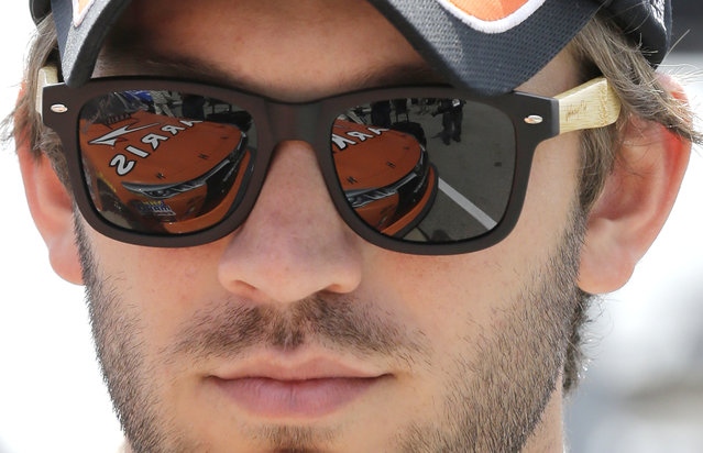 Daniel Suarez (18) checks his car before the NASCAR Xfinity series auto race at Chicagoland Speedway, Sunday, June 21, 2015, in Joliet, Ill. (AP Photo/Nam Y. Huh)