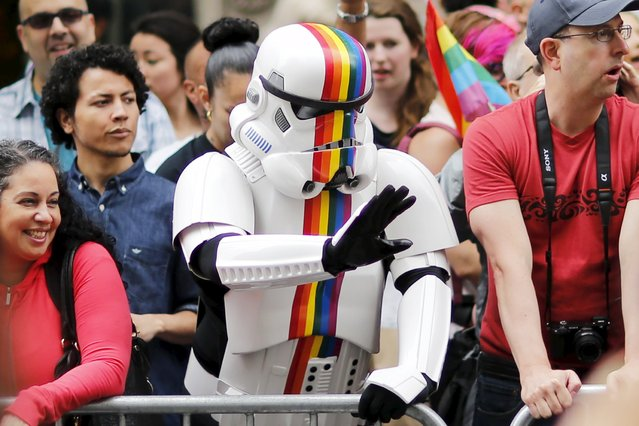 A person dressed as a Stormtrooper from Star Wars (C) waves to marchers during the annual Gay Pride parade in New York June 28, 2015. (Photo by Eduardo Munoz/Reuters)