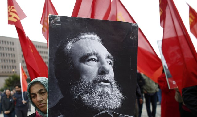 A woman carries a portrait of Cuba's former president Fidel Castro during a May Day rally in Istanbul, Turkey, May 1, 2016. (Photo by Murad Sezer/Reuters)
