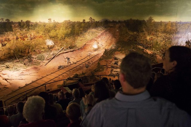 Visitors view the Atlanta Cyclorama, the colossal Civil War painting created about 130 years ago, Tuesday, June 30, 2015, in Atlanta. Cyclorama officials say Tuesday is the last day visitors can see the 15,000-square-foot oil painting in Grant Park before it leaves the building it has occupied since 1921 to move across town. After the Cyclorama closes late Tuesday afternoon, the painting will be prepared for its move to a new addition being constructed at the Atlanta History Center. (Photo by David Goldman/AP Photo)