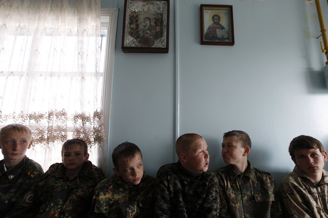 Students from the General Yermolov Cadet School sit in an Orthodox service during a two-day field exercise near the village of Sengileyevskoye, just outside the south Russian city of Stavropol, April 13, 2014. (Photo by Eduard Korniyenko/Reuters)