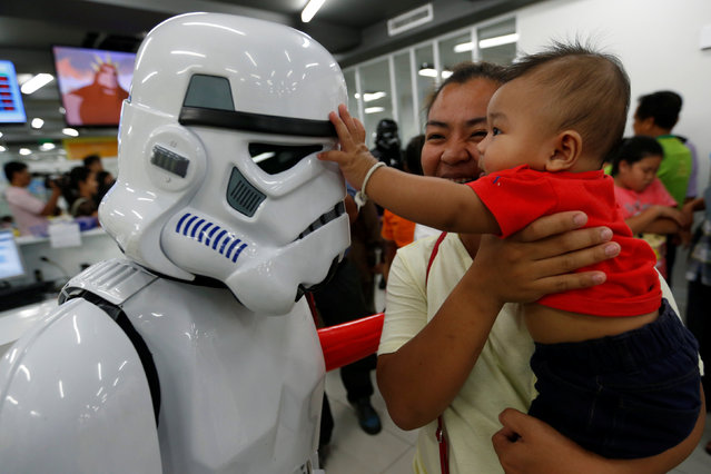 A member of a Star Wars fan club in Thailand, dressed as a Stormtrooper plays with a child during Star Wars Day celebration at the Queen Sirikit National Institute of Child Health in Bangkok, Thailand, May 4, 2016. (Photo by Chaiwat Subprasom/Reuters)