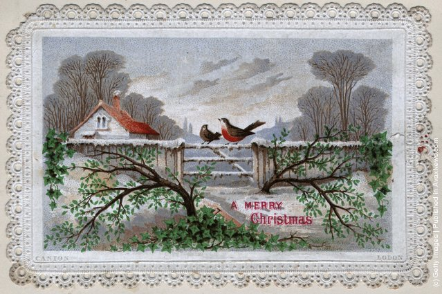 1899: A robin sitting on the gate of a house in the midst of a snow scene with a Christmas message