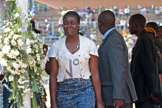 A woman weeps at the public viewing of the body of late former Zimbabwean president Robert Mugabe in the coffin as it is lying in state in Harare, Zimbabwe, 13 September 2019. Mugabe passed away on 06 September aged 95 in Singapore where he had been receiving treatment since April this year. Mugabe led the country post-independence from 1980 to 2017 when he was ousted in a military coup. The public will be able to pay their respects to Mugabe on 12 and 13 September in Harare before his burial on 15 September. (Photo by Aaron Ufumeli/EPA/EFE)