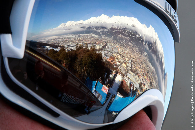 A reflection of the Alps mountain Nordkette is seen in the ski googles of Anders Bardal of Norway