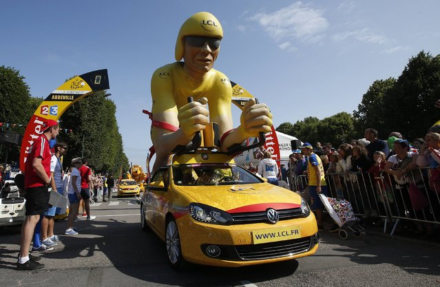 LCL Bank and leader's yellow jersey main sponsor publicity vehicle from the Tour de France caravan is seen at the start of the 191.5-km (118.9 miles) 6th stage of the 102nd Tour de France cycling race from Abbeville to Le Havre, France, July 9, 2015. (Photo by Eric Gaillard/Reuters)
