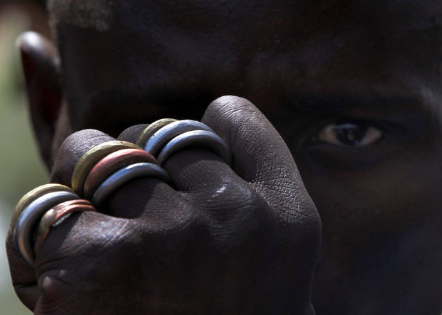 A man poses for a picture to show his rings of gold, silver and bronze on his fist in Zamfara, Nigeria April 21, 2016. (Photo by Afolabi Sotunde/Reuters)
