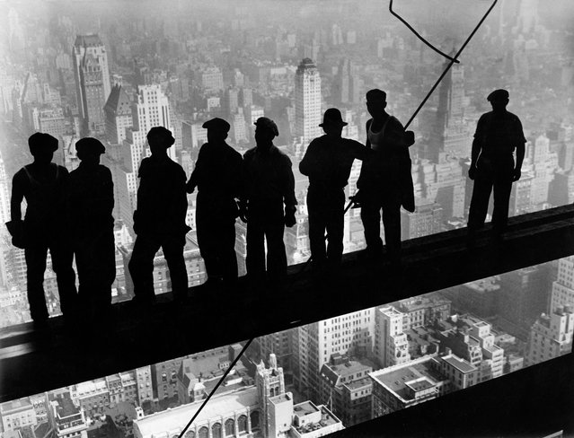 Sky scrapers Construction workers on an iron girder at the Empire State Building construction site, 1932. (Photo by Lewis W. Hine/ullstein bild via Getty Images)