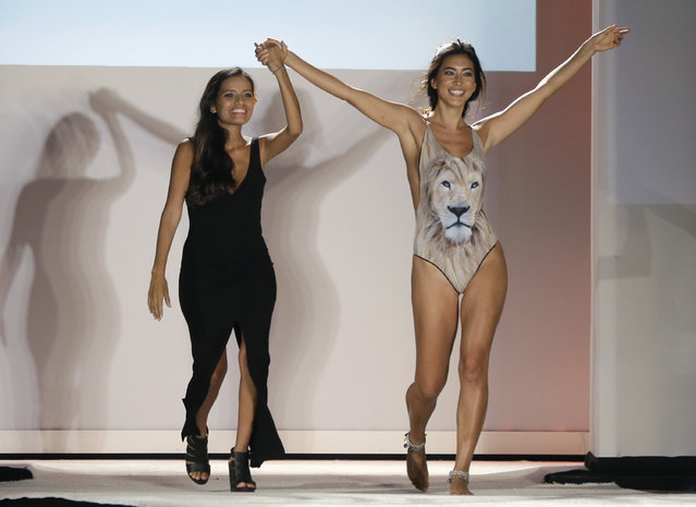 Designer Lisseth Figueroa, left, walks with a model on the runway during the San Lorenzo Bikinis swimwear show as part of Funkshion Fashion Week Swim, Saturday, July 18, 2015, in Miami Beach, Fla. (Photo by Lynne Sladky/AP Photo)