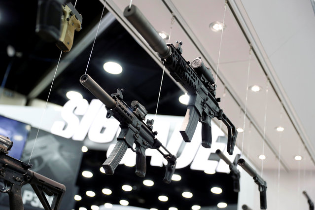 Guns are seen on display in the trade booths during the National Rifle Association's annual meeting in Louisville, Kentucky, May 21, 2016. (Photo by Aaron P. Bernstein/Reuters)