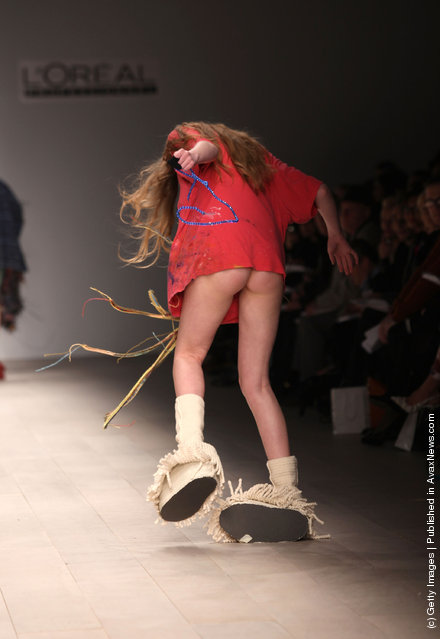 A model walks the runway during the Central Saint Martins MA Fashion show featuring student Luke Brooks at London Fashion Week Autumn/Winter 2012