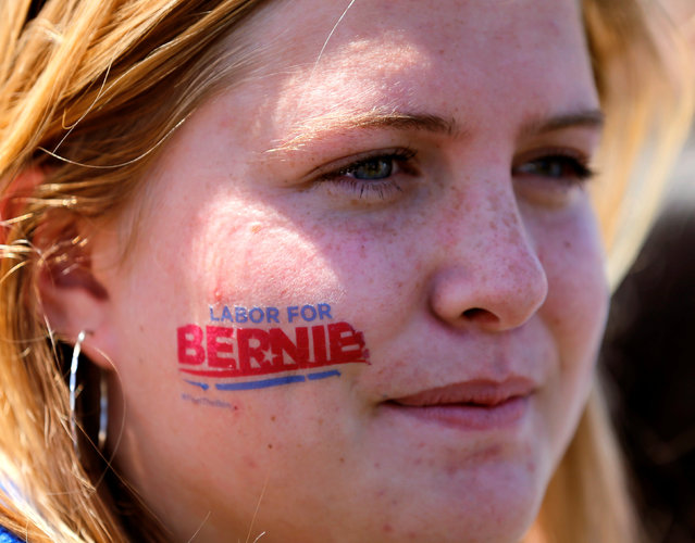 A young female supporter wears a tattoo on her face as she attends a rally for U.S. Democratic presidential candidate Bernie Sanders in Vista, California, United States May 22, 2016. (Photo by Mike Blake/Reuters)