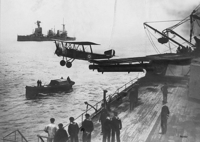 "A Sopwith 1 1/2 Strutter biplane aircraft taking off from a platform built on top of HMAS Australia's midships ""Q"" turret, in 1918. (Photo by State Library of New South Wales via The Atlantic)"