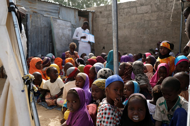 Children attend a class at a makeshift pre-school supported by Save the Children in Maiduguri, Nigeria February 14, 2017. (Photo by Paul Carsten/Reuters)