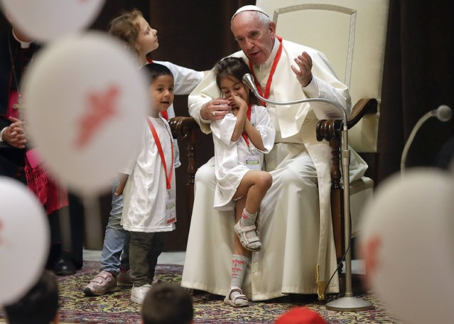 Pope Francis meets children from the central Italy quake struck areas, in the Paul VI Hall at the Vatican, Saturday, June 3, 2017. (Photo by Alessandra Tarantino/AP Photo)