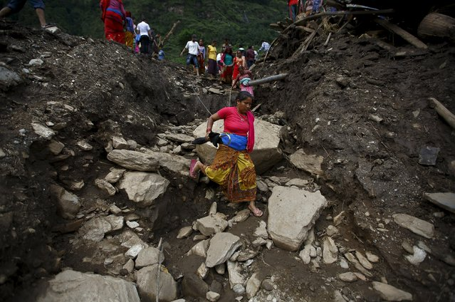 A woman walks along the landslide-affected area at Lumle village in Kaski district July 30, 2015. (Photo by Navesh Chitrakar/Reuters)