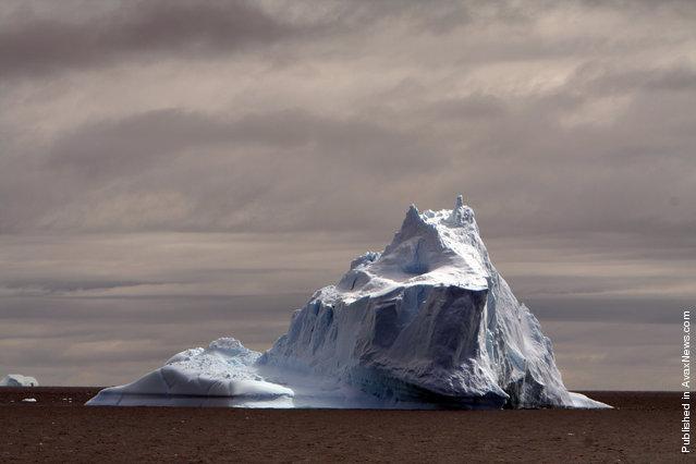 A large iceberg floats off the coast of Antarctica