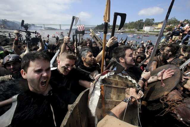 People dressed up as Vikings take part in the annual Viking festival of Catoira in north-western Spain August 2, 2015. (Photo by Miguel Vidal/Reuters)