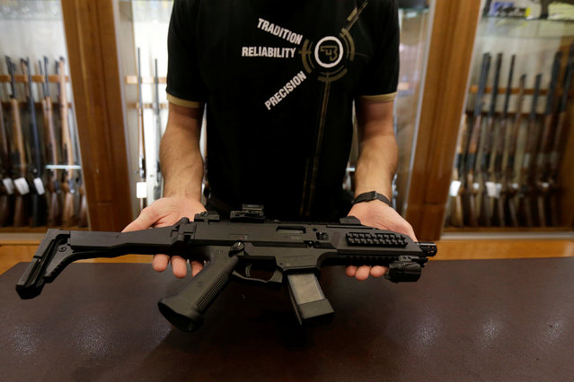 A salesman shows an assault rifle at Ceska Zbrojovka weapons factory shop in Prague, Czech Republic, May 31, 2016. (Photo by David W. Cerny/Reuters)