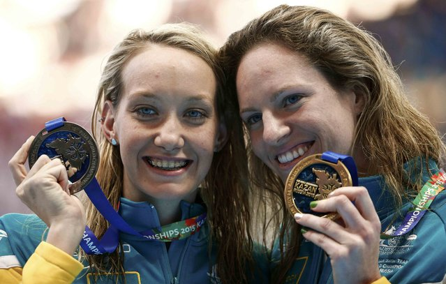 Australia's second placed Madison Wilson (L) and her first placed compatriot Emily Seebohm pose with medals after the women's 100m backstroke final at the Aquatics World Championships in Kazan, Russia, August 4, 2015. (Photo by Hannibal Hanschke/Reuters)