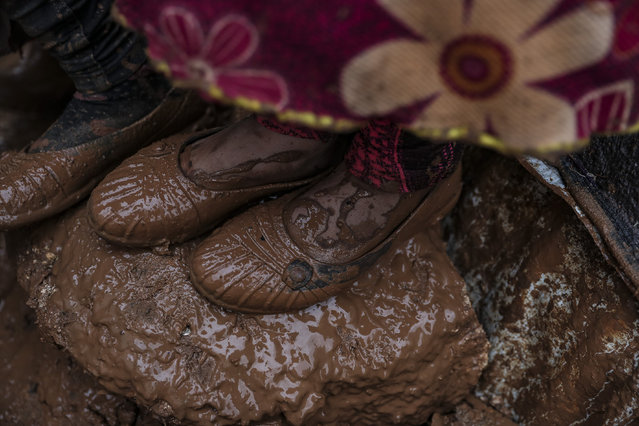 Shoes of a Syrian kid are seen in mud at Sarut Camp in Sarmada district of Idlib, Syria on January 6, 2020. About 130 families, fled from Assad regime and Russian attacks in Syria and moved to safe areas in Idlib, live in harsh conditions at the camp due to puddle caused by heavy rainfall and lack of infrastructure. (Photo by Esra Hacioglu/Anadolu Agency via Getty Images)