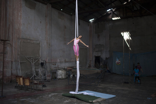 Circus performer Olga Morales, 18, takes part in a training session in Havana, September 25, 2014. (Photo by Alexandre Meneghini/Reuters)