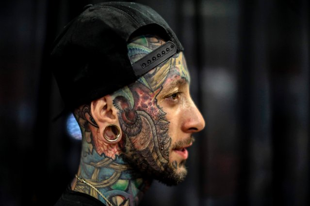 Tattoo enthusiast known as Iverson poses for a photo during the 8th Expotattoo Colombia Fair in Medellin, Antioquia department, on July 14, 2017. (Photo by Joaquin Sarmiento/AFP Photo)
