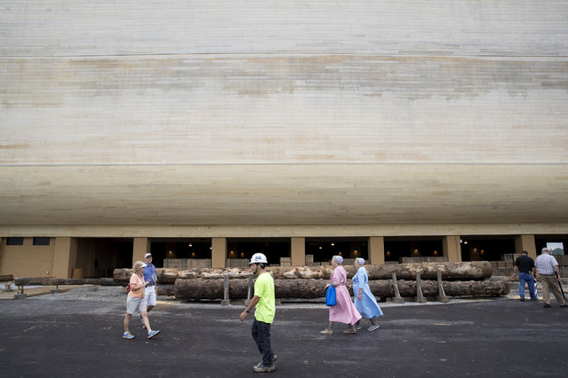 Patrons and construction workers walk outside the Ark Encounter July 5, 2016 in Williamstown, Kentucky. (Photo by Aaron P. Bernstein/Getty Images)