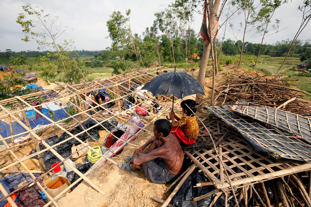 Rohingya refugees sit in front of their house which has been destroyed by Cyclone Mora at the Balukhali Makeshift Refugee Camp in Cox's Bazar, Bangladesh May 31, 2017. (Photo by Mohammad Ponir Hossain/Reuters)