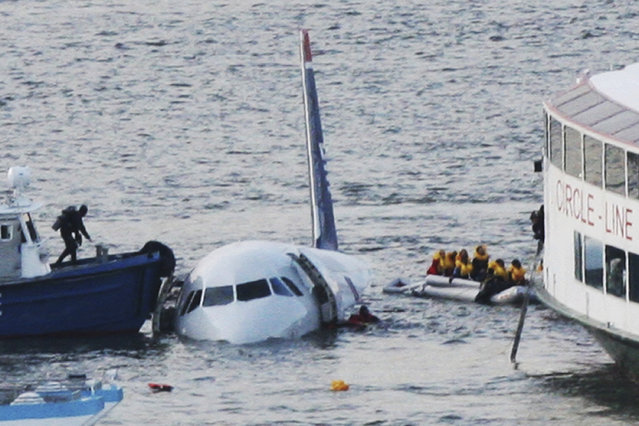 "In this January 15, 2009 file photo, a diver, left, aboard an NYPD vessel prepares to rescue passengers that escaped from the Airbus 320 US Airways aircraft made an emergency landing in the Hudson River in New York in what came to be known as the ""Miracle on the Hudson"" because everyone survived. It's been 10 years since US Airways flight 1549 landed on the Hudson River after colliding with a flock of geese just after takeoff. (Photo by Bebeto Matthews/AP Photo)"