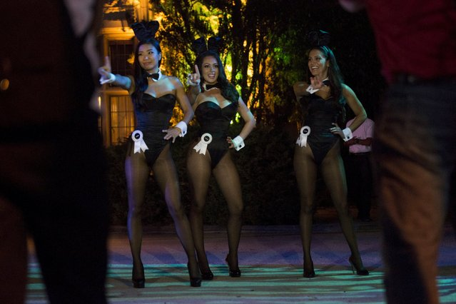 """Playboy Bunnies dance at the premiere of """"The Transporter Refueled"""" at Playboy Mansion in Los Angeles, California August 25, 2015. (Photo by Mario Anzuoni/Reuters)"""