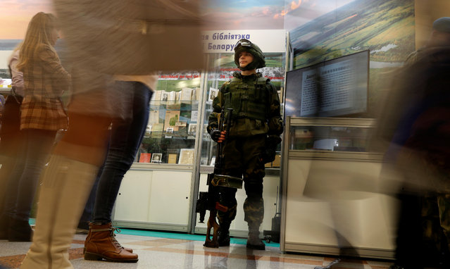 A Belarusian soldier with a machine gun stands at an exposition during the XXVII Minsk International Book Fair in Minsk, Belarus on February 5, 2020. (Photo by Vasily Fedosenko/Reuters)