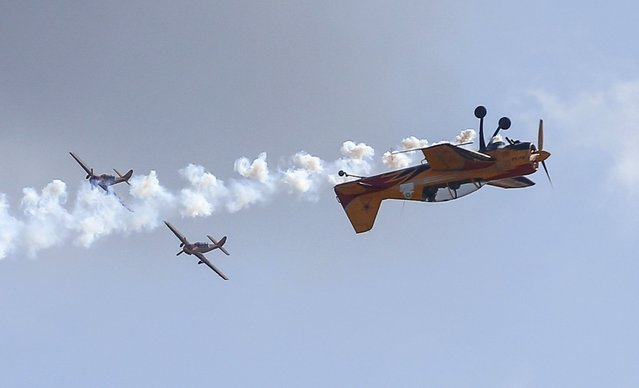 Yakovlev Yak-54 (R) and SP-129 trainer aircrafts of Russia's Pervy Polet (First Flight) aerobatic team perform during the MAKS International Aviation and Space Salon in Zhukovsky, outside Moscow, Russia, August 29, 2015. (Photo by Maxim Shemetov/Reuters)