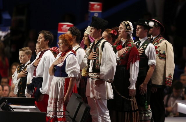 "A group that the Republican National Convention described as its ""Patriotic Nationality Ambassadors"" lead the convention in the U.S. Pledge of Allegiance at the start of the second session of the Republican National Convention in Cleveland, Ohio, U.S., July 19, 2016. (Photo by Carlo Allegri/Reuters)"