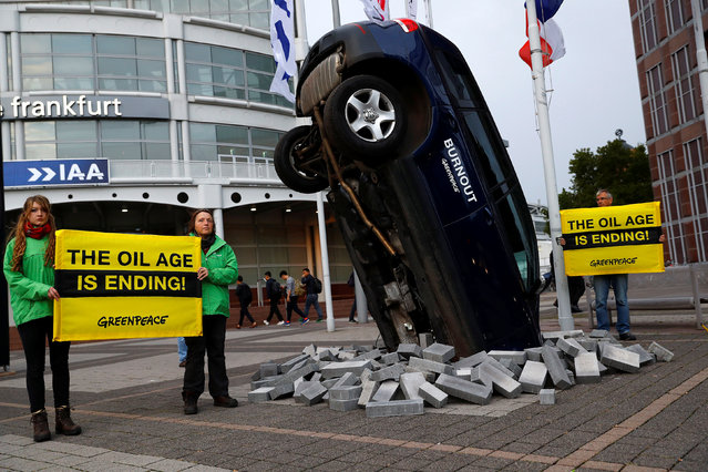 Greenpeace activists take part in a demonstration in front of the main entrance of the Frankfurt Motor Show (IAA) in Frankfurt, Germany September 12, 2017. (Photo by Kai Pfaffenbach/Reuters)